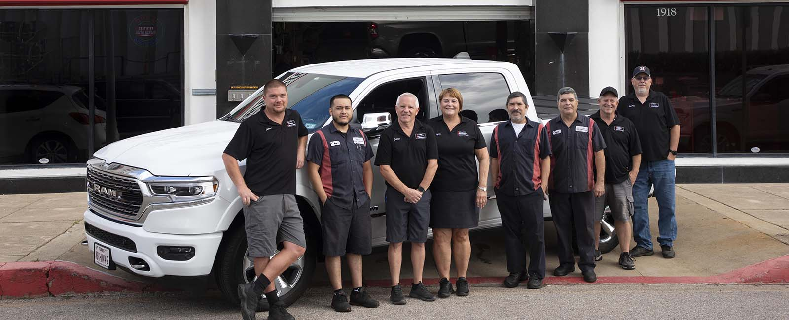 Galveston Automotive Professionals team leaning on packard